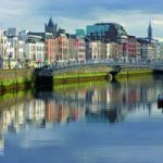 Dublin landscape, river and a bridge and high rise buildings in the back of the image