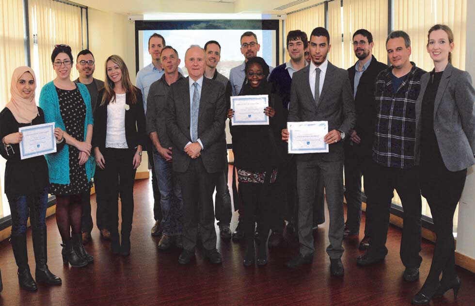 DIFC students at awards ceremony with DIFC staff members.