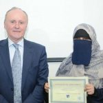 DIFC Student with certificate and DIFC staff member