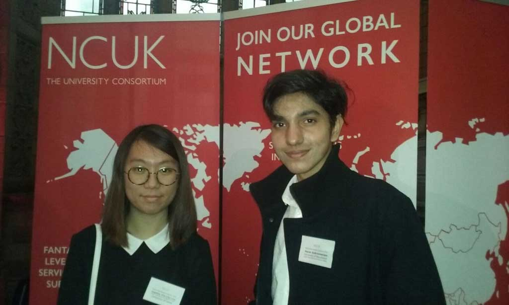 Two DIFC students pictured infront of a NCUK sign