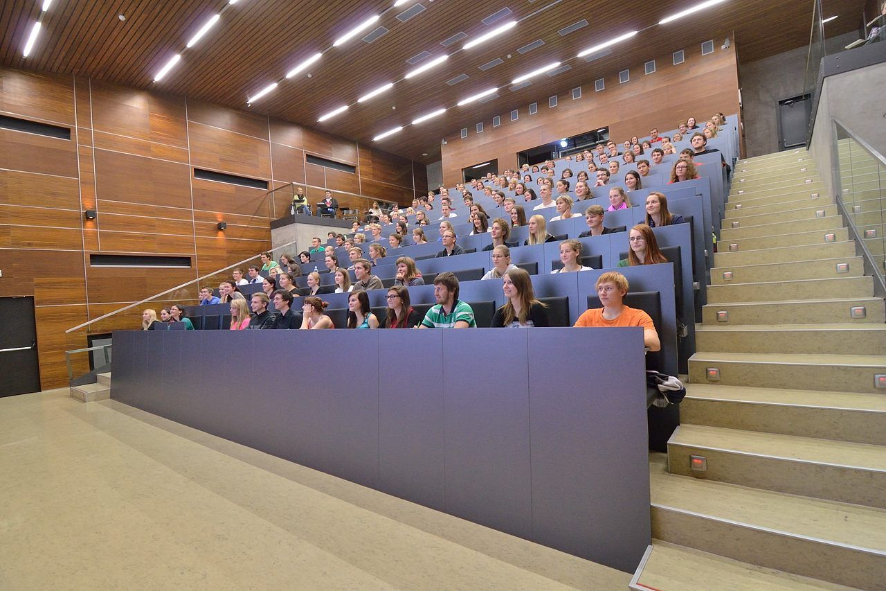 Charles University Prague lecture hall with students sitting in rows of desks