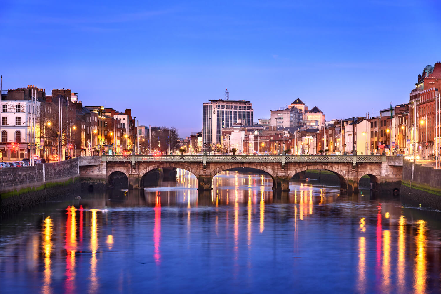 River Liffey flowing under a bridge, with the street lights reflecting on the water