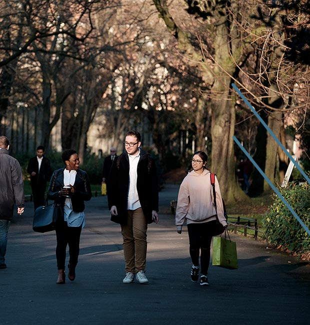 DIFC students walking through a park